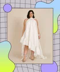 Model wears white silky high-low gown.