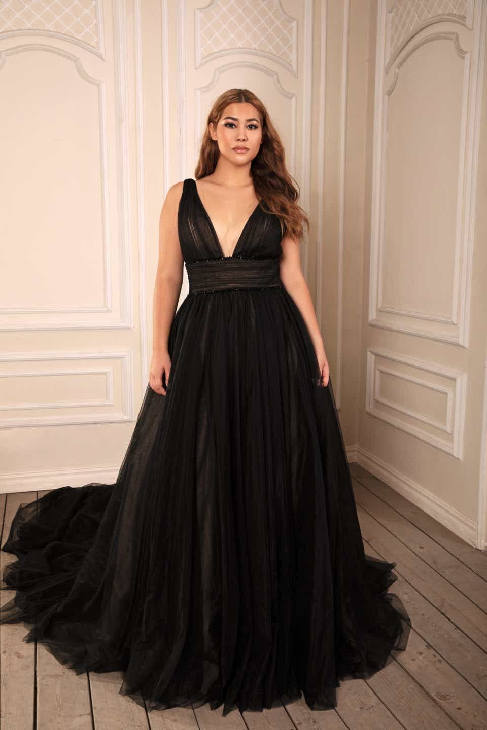 a black dress with plunging neckline by dany tabet